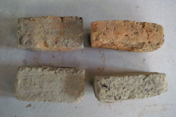 Top: Sun-dried red bricks. Bottom: Sun-dried mud bricks. Note the ridges on the top of both bricks, and the variation in shape and size. Photo: I. Hill.