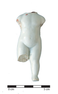 A pudding doll, or 'frozen charlotte' found at the site, suggesting the presence of children. Image: K. Bone.