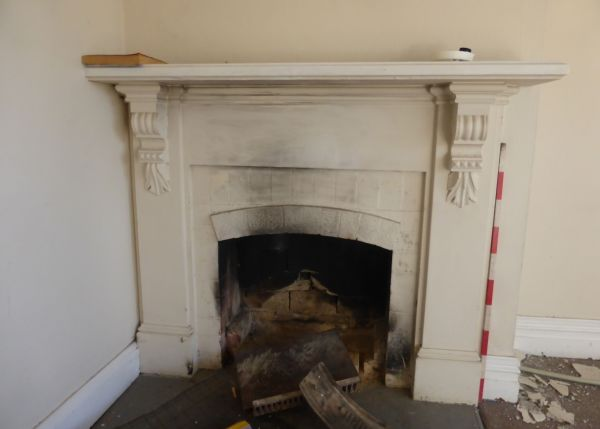 Another modified 19th century fireplace, with 20th century bricks in a timber surround. Image: P. Mitchell.